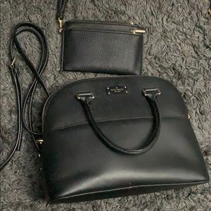 Kate spade black purse comes with strap.